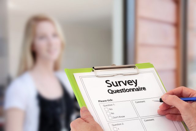 Girl Answering Market Research Survey Questionnaire at the Door